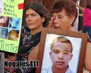 The grandmother of Jose Antonio holds a picture of him at a vigil